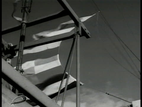 sailor raising signal flags. flags blowing. int man turning valve wheel in engine room. bridge of tanker. int vs radio operator w/ headphones.... - atlantic ocean stock videos & royalty-free footage