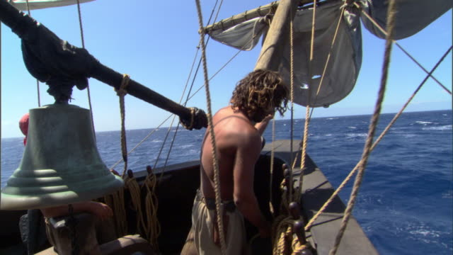 stockvideo's en b-roll-footage met a sailor secures ropes on a ship. - matroos