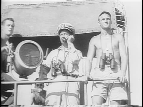 sailor signals from navy ship / general macarthur lands 6th army on morotai / infantry disembarks ship goes through water to shore / men wade through... - general macarthur stock videos & royalty-free footage