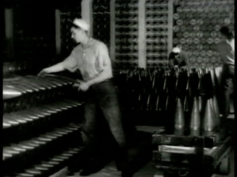 sailor stocking artillery shells into crate shelves of shells bg. sailor turning propeller of torpedo another cleaning painting torpedo wall of... - torpedo stock videos & royalty-free footage