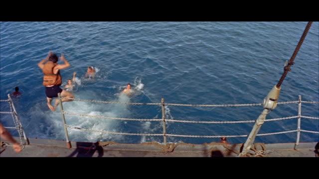 ms sailor swimming in water - 水泳パンツ点の映像素材/bロール