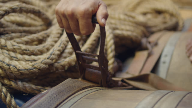 sailor tightens wratchet strap in ship, grenada - rope stock videos & royalty-free footage