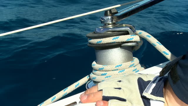 hd slow motion: sailor turning the winch - sailing boat stock videos and b-roll footage
