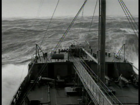 sailor w/ binoculars looking out window ws stern of deck turbulent seas officer standing ms tanker at high seas waves atlantic ocean vs convoy at sea... - convoy stock videos & royalty-free footage