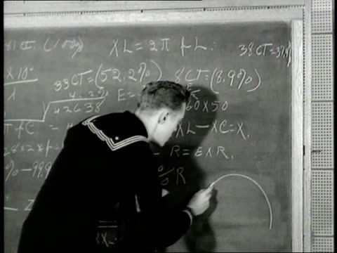 a us sailor writes mathematical equations on a chalkboard - mathematical symbol stock videos & royalty-free footage