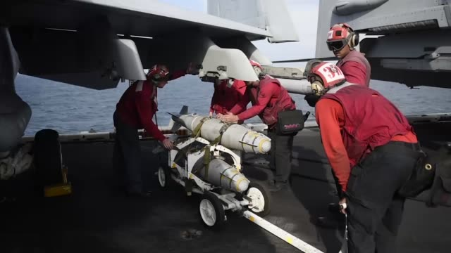 sailors aboard the aircraft carrier uss theodore roosevelt load ordnance onto aircraft during combat flight operations in the us 5th fleet area of... - military training stock videos & royalty-free footage