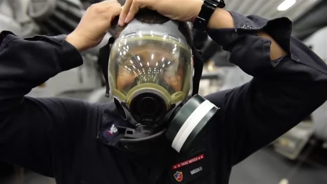 sailors aboard waspclass amphibious assault ship uss essex conduct a chemical biological and radiological drill throughout the ship the essex... - ガスマスク点の映像素材/bロール