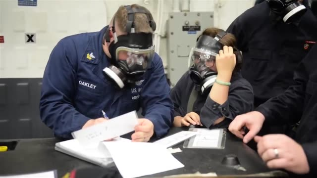Sailors aboard Waspclass amphibious assault ship USS Essex conduct a chemical biological and radiological drill throughout the ship The Essex...