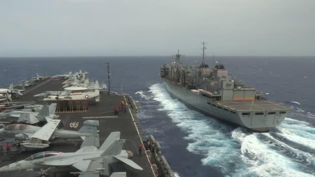 sailors and marines conduct a replenishment at sea aboard the aircraft carrier uss nimitz alongside usns rainier . - röda havet bildbanksvideor och videomaterial från bakom kulisserna