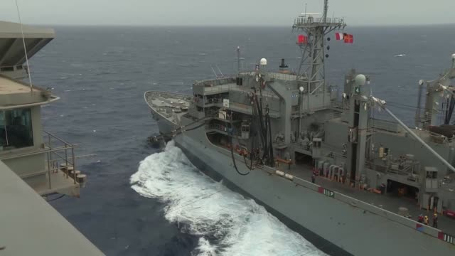sailors and marines conduct a replenishment at sea aboard the aircraft carrier uss nimitz alongside usns rainier . - refuelling stock videos & royalty-free footage