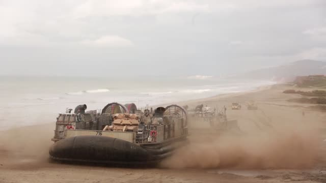 sailors and marines conduct an amphibious breach training marine corps base camp pendleton, california, january 12, 2019. - ホバークラフト点の映像素材/bロール