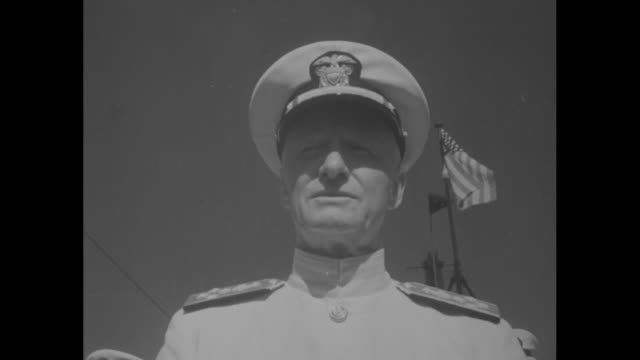 sailors and officers and others standing on deck of submarine / tilt-up us admiral chester nimitz speaking; blue sky and us flag in bg / nimitz... - tower stock videos & royalty-free footage