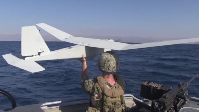 sailors assigned to commander task group 567 coastal riverine squadron 3 launch and recover puma ae unmanned aerial vehicle during exercise eager... - 無人航空機点の映像素材/bロール