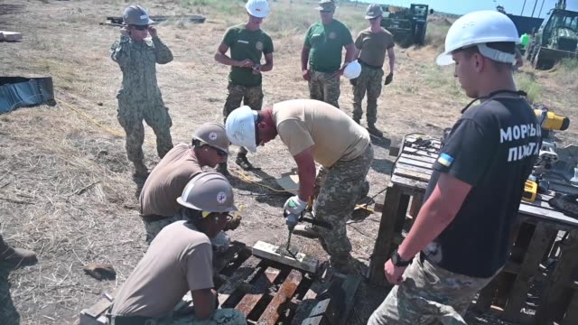 us sailors assigned to naval mobile construction battalion work with ukranian marines in constructing a sentry post during exercise sea breeze 2019... - drill bit stock videos and b-roll footage
