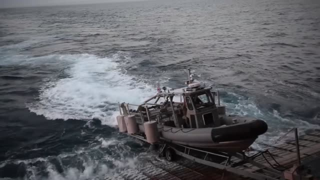 sailors assigned to the amphibious dock landing ship uss harpers ferry explosive ordnance disposal mobile unit the united kingdom's royal navy royal... - boat ramp stock videos & royalty-free footage