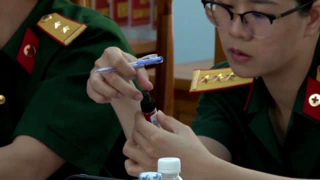 Sailors assigned to the US Navy hospital ship USNS Mercy conduct a blood transfusion workshop with doctors at Military Hospital 87 in Nha Trang...