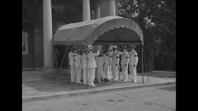 vídeos y material grabado en eventos de stock de sailors carry coffin of adm john s mccain sr to fort myer memorial chapel as officers under awning salute / honor guard / wide shot of chapel and men... - fort myer