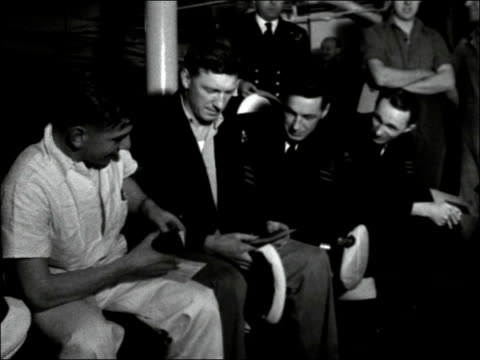 sailors from hms vanguard give blood aboard ship england portsmouth vanguard at anchor / cu name / ms curses coming aboard / cs naval hats of all... - card table stock videos and b-roll footage