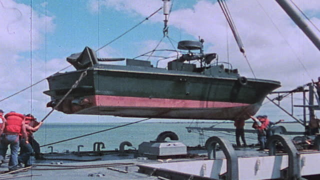 sailors hoisting river patrol boat aboard uss harnett county for maintenance in the mekong delta / vietnam - hoisting stock videos & royalty-free footage