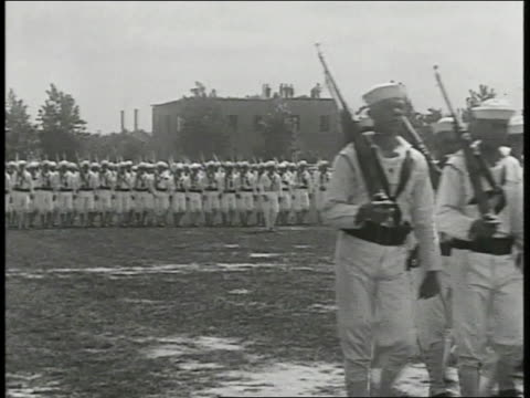 sailors in uniform marching w/ rifles on open field us army soldiers in firing line w/ rifles shooting weapons other soldiers standing bg - 1918 stock videos and b-roll footage