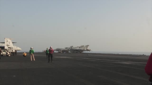 sailors launch and recover aircraft from the flight deck of the aircraft carrier uss george hw bush supporting strike surveillance and reconnaissance... - bush stock videos & royalty-free footage