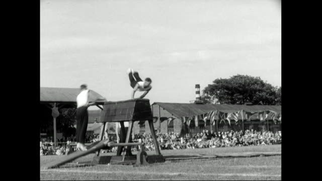 sailors leap and somersault over gymnastics equipement;1951 - competition stock videos & royalty-free footage
