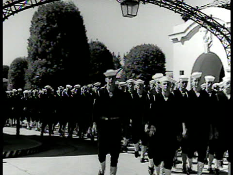 sailors marching through gate ms various naval specialist patches la ms cadets signaling w/ blinker light ms student aiming cannon w/ scope wwii - fadenkreuz stock-videos und b-roll-filmmaterial