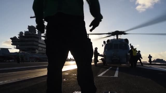 sailors of helicopter maritime strike squadron 70 launch a mh60r sea hawk off the flight deck of the aircraft carrier uss george hw bush cvn 77 ghwb... - bush stock videos & royalty-free footage