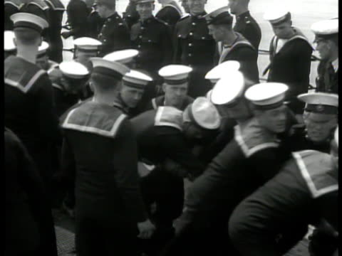 sailors on deck raising british flag guards fg. sailors hauling rope on deck. looking through telescope. int vs officers around table looking at... - bandiera del regno unito video stock e b–roll