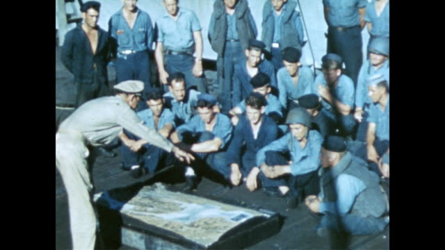 sailors on deck sitting around large map listening to officer speak. - 1944 stock videos & royalty-free footage