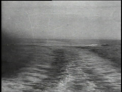 sailors on rear of moving ship dropping depth charges in wake - 1918 stock videos and b-roll footage