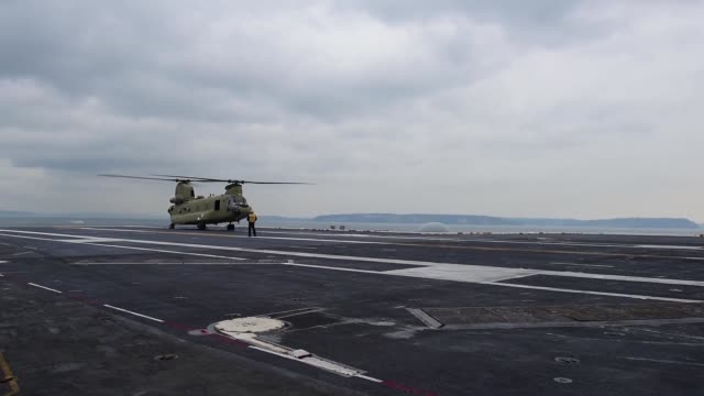 sailors on uss john c stennis direct a washington national guard ch47 chinook and a united states coasst guard mh65 dolphin in deck landing... - aircraft carrier stock videos & royalty-free footage