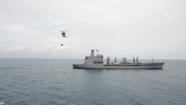 sailors participate in a replenishmentatsea aboard military sealift command hospital ship usns mercy where mercy received fuel and supplies from the... - henry j. kaiser stock videos and b-roll footage
