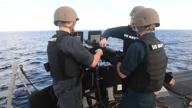 sailors participate in a small caliber action team qualification shoot aboard the arleigh burkeclass guidedmissile destroyer uss stockdale in the... - small stock videos & royalty-free footage