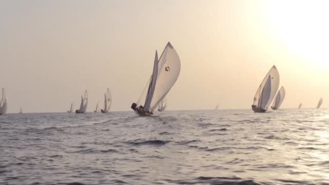 sailors participate in the annual long distance dhow sailing race known as al gaffal meant to honour the lost tradition of pearl diving that kicked... - tradition stock videos & royalty-free footage