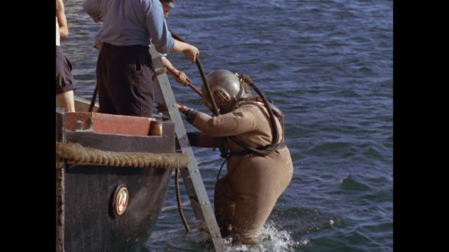 vídeos de stock, filmes e b-roll de sailors practice diving in malta's grand harbor - diving suit