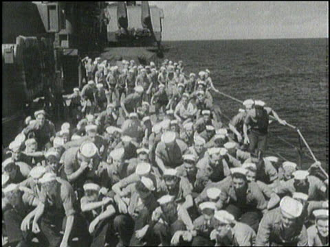 sailors put on goggles to watch a hydrogen bomb explosion from the deck of a ship. - skibrille stock-videos und b-roll-filmmaterial