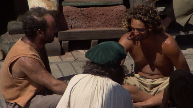 stockvideo's en b-roll-footage met sailors relax on the deck of a 15th century sailing ship. - rond de 15e eeuw