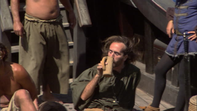vídeos y material grabado en eventos de stock de sailors relax on the deck of a 15th century sailing ship. - buque