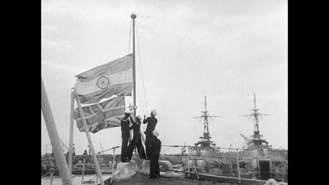 sailors replacing british flag w/ india flag. map of india showing 'partition of india' and map of punjab region. war zone: punjab area street... - anno 1947 video stock e b–roll
