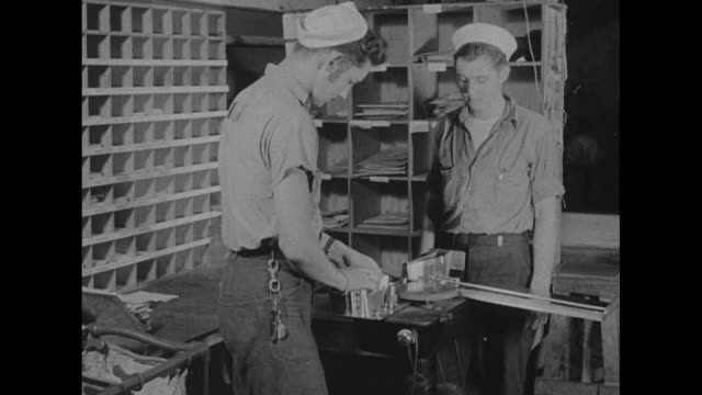 vs sailors sort packets of mail / sailor sends letters through machine mail counter / vs sailors sort mail into boxes labeled with states' names /... - satchel stock videos & royalty-free footage