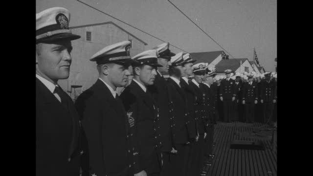 ws sailors stand at attention on deck of uss tirante for 1945 ceremony involving presentation of presidential unit citation / vs officers sailors... - plakette stock-videos und b-roll-filmmaterial