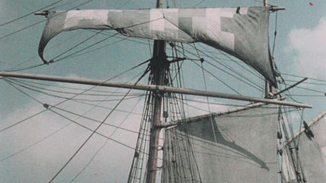 1937 montage sailors unfurling the topsail of the schooner katie and setting the jib during departure / dartford, england, united kingdom - sailing ship stock videos & royalty-free footage