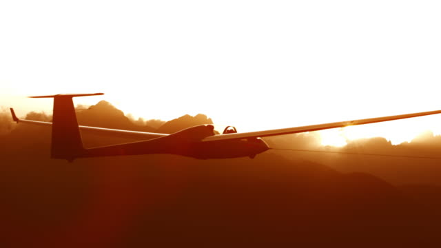 sailplane high in the sky at sunset - gliding stock videos and b-roll footage