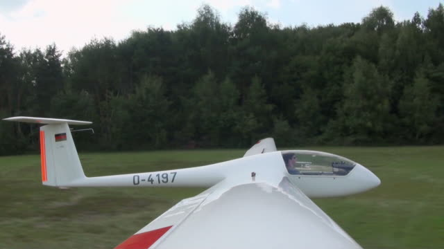 ws sailplane landing on runway / konz-koenen, saar-valley, rhineland-palatinate, germany - gliding stock videos and b-roll footage
