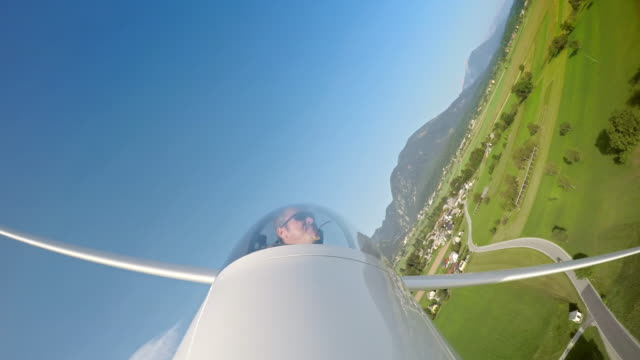 ld sailplane pilot smiling while gliding across the sky on a sunny day - glider stock videos & royalty-free footage
