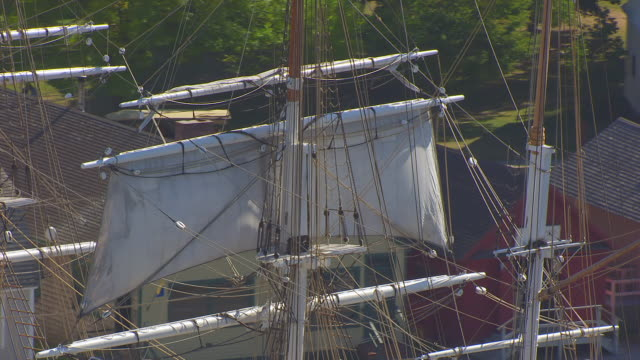 ws aerial pov sails and rigging of charles w. morgan ship with american flag/ mystic, connecticut, united states - rigging stock videos & royalty-free footage