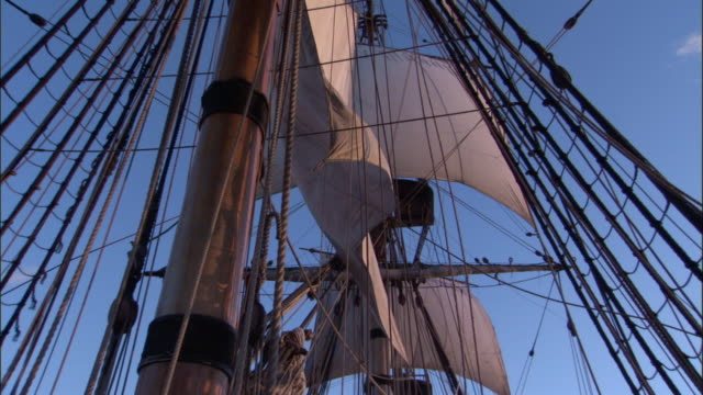 Sails and rigging of replica HMS Endeavour flap in breeze.