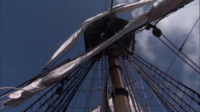 Sails being unfurled on replica of HMS Endeavour.