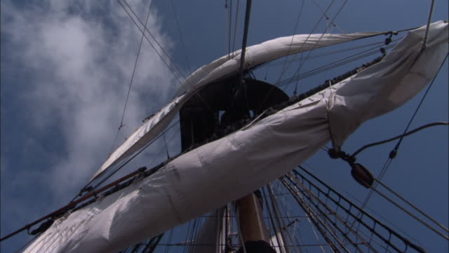 Sails billow as they're furled on replica of HMS Endeavour.